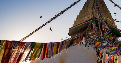 The Buddhist stupa of Boudhanath dominates the skyline. The ancient Stupa is one of the largest in the world. As of 1979, Boudhanath is a UNESCO World Heritage Site